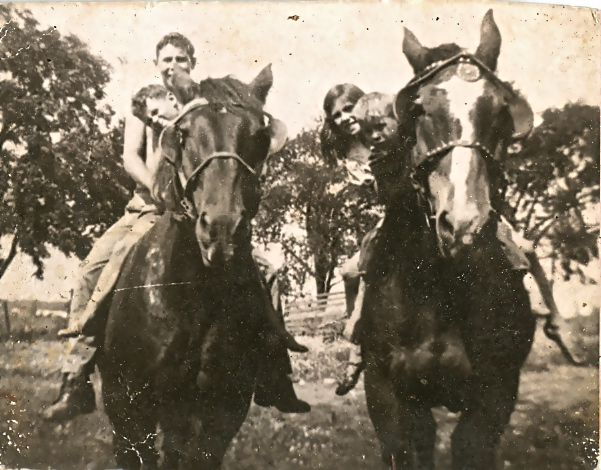 Four of my Mom's six siblings on work horses, Tom and Mike