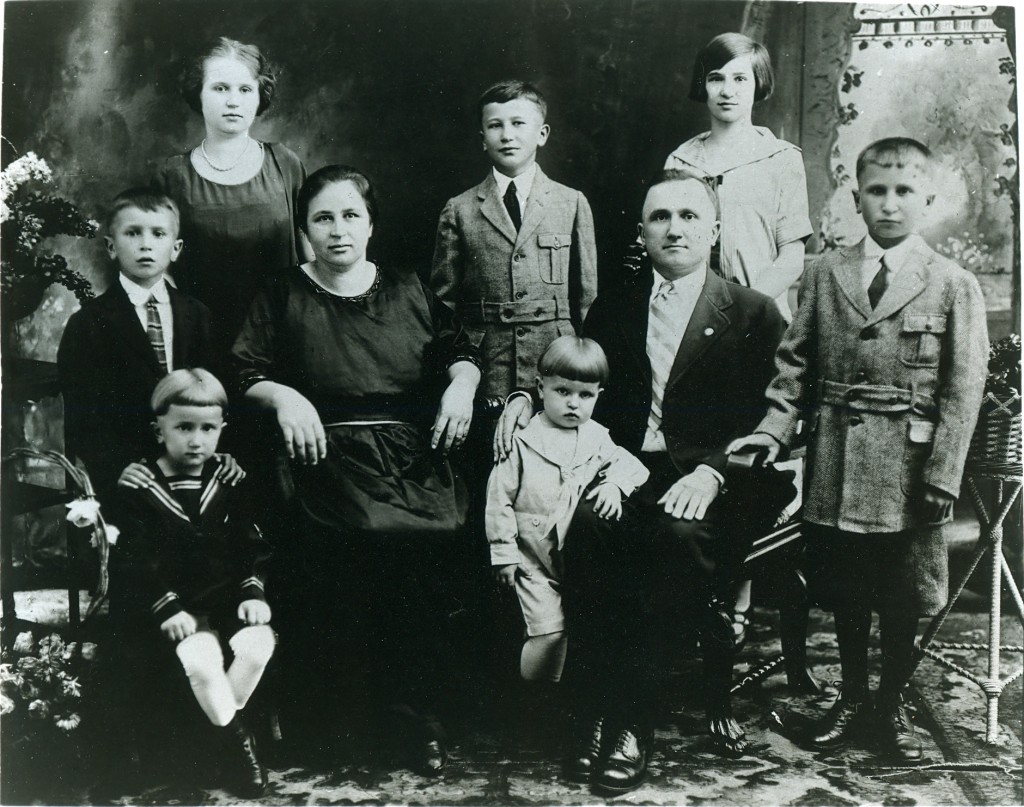 My grandmother in the white dress, surrounded by her parents and siblings.