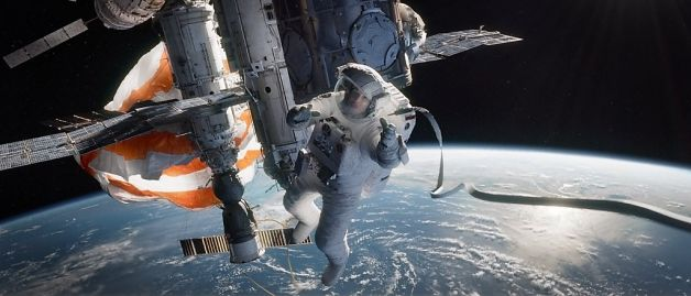 Sandra Bullock trying to survive in the film, Gravity.