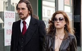 Christian Bale and Amy Adams are the small time con artists in American Hustle
