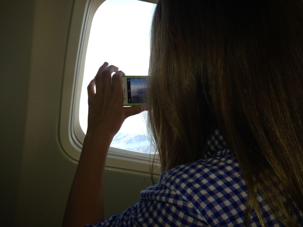Photo of my 12-year-old niece from the airplane on our trip to Burbank and Universal Studios.