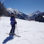 Skiing at the top of Buttermilk in Aspen with Pyramid Peak pin the distance.