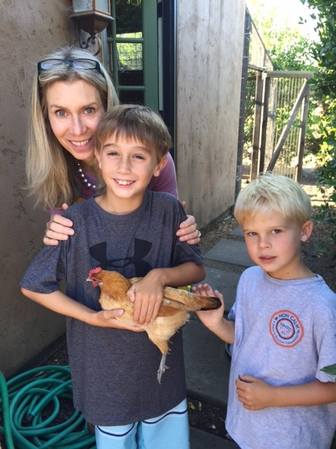 Our grandsons with one of our Nankin hens. Trueheartgal.