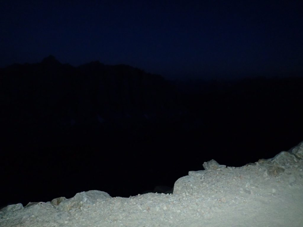 Headlight view of the edge of the trail at the break spot. Life lessons learned on Mt. Whitney, the highest peak in the lower 48.