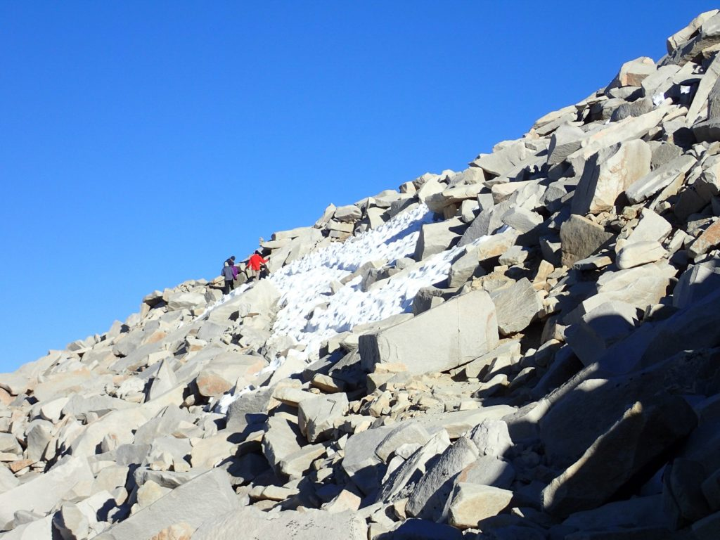 Some other hikers on the far side of an icy snow patch. Mt. Whitney. Mount Whitney.