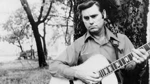 George Jones with a guitar